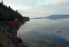 Walking the shoreline on Walker`s Hook Road. On Salt Spring Island, British Columbia part of the southern Gulf Islands on BC west coast of Canada.  A winter walk Stock Photo