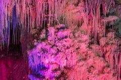 Salt stalactite in salt mine. Salt stalactite in underground salt mine in colour cast stock photos