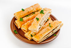 Salt sticks with cheese, ham & green Stock Photography