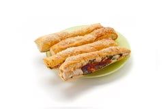 Salt sticks with cheese, ham & green Stock Image