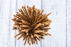 Salt Sticks. (close-up shot) on bright wooden background Royalty Free Stock Images