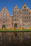 Salt storage buildings along a canal in Lubeck Stock Photo