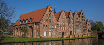 Salt storage buildings along a canal in Lubeck Royalty Free Stock Photography