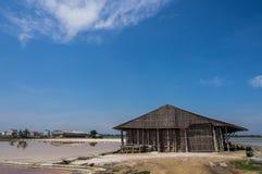 Salt storage in salt farm. And blue sky Stock Image