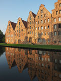 Salt storages of Luebeck, Germany. Salt storages of Luebeck and its mirroring in the river Stock Photography
