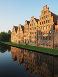 Salt storages of Luebeck, Germany. Salt storages of Luebeck and its mirroring in the river Stock Image