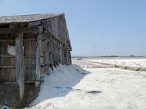 Salt storehouse for collect dried salt from saline. Wooden salt shed and sea salt field in Samutsongkram Province Thailand stock photography