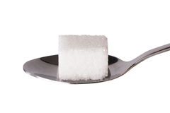 Salt or sugar on a teaspoon isolated Royalty Free Stock Photo