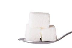 Salt or sugar on a teaspoon isolated Stock Photography