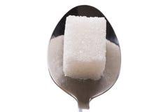 Salt or sugar on a teaspoon isolated Royalty Free Stock Image