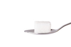 Salt or sugar on a teaspoon isolated Royalty Free Stock Image