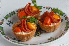 Salt tartlets with peperoni and parsley. Salt Tartlets with salad, mayonnaise, paprika, dill Royalty Free Stock Image
