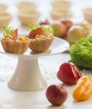Salt tartlets with  peperoni. With Salad, cucumber Stock Photos