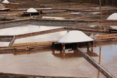 Salt terraces. Parcial view of a salt mine located in Rio Maior - Portugal.  the terraces and pine boards with plenty of white salt Stock Photography