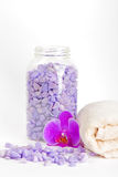 Salt, towel and orchid Stock Photos