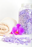 Salt, towel and orchid Royalty Free Stock Photography