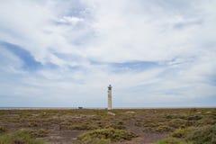 Salt träsk och fyr, Morro Jable, Fuerteventura Arkivfoto