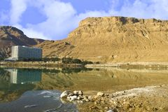 Salt and water. Reflection of hotel in �������� to water of Dead lake in Israel royalty free stock photo