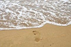 Salt water flow to foot step on the beach. Salt water flowing to foot step on the beach royalty free stock photos