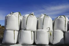 Salt white sacks rows stacked to road ice Royalty Free Stock Image