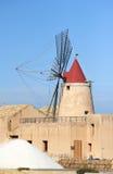 Salt and windmill. Old windmill from Marsala salinas Stock Image