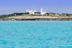 Salt windmill in Formentera turquoise sea Royalty Free Stock Image