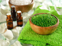 Salt in a wooden bowl and essential oil Royalty Free Stock Image