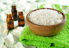 Salt in a wooden bowl and essential oil Royalty Free Stock Photos