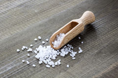 Salt on wooden scoop Stock Images