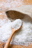 Salt and a wooden spoon Royalty Free Stock Image