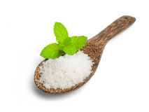 Salt in a wooden spoon Royalty Free Stock Images