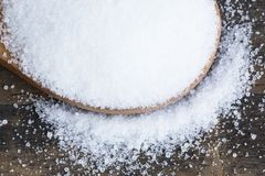 Salt in a Wooden Spoon. Close Up royalty free stock photo
