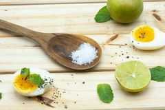 Salt in wooden spoon on the table Royalty Free Stock Image