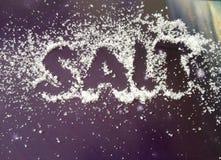 Salt. The word write in salt. Royalty Free Stock Photos