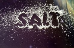 Salt. The word write in salt. royalty free stock photography