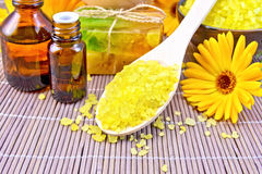 Salt yellow and oil with calendula on bamboo Stock Images