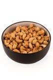 saltade isolerade bruna cashews för bunken white Arkivfoton