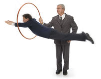 Saltando attraverso i cerchi Immagine Stock