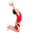 Saltando las manos del niño estiradas al cielo fotos de archivo libres de regalías