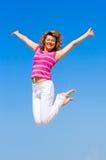 Saltando nella gioia Fotografie Stock Libere da Diritti