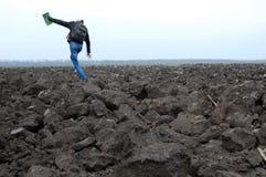 Saltando sul suolo Fotografia Stock