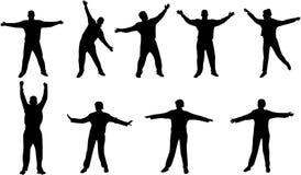 saltando y gozando de siluetas Imagen de archivo libre de regalías