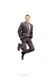 Saltar alegre do homem de negócios da felicidade fotos de stock