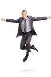 Saltar do homem de negócios da felicidade imagens de stock royalty free