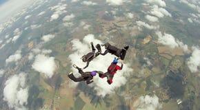 Saltar en caída libre al equipo de 4 maneras imagen de archivo libre de regalías