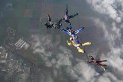 Saltar en caída libre al grupo Fotos de archivo