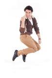 Saltar entusiasmado do homem da alegria que consegue o sucesso Fotografia de Stock Royalty Free