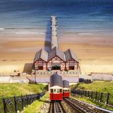 Saltburn by the Sea Cliff Railway. Cliff railway at Saltburn by the Sea, North Yorkshire, England, UK, with the pier behind Royalty Free Stock Images