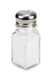 Saltcellar en verre avec du sel isolé Image stock
