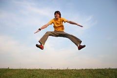 Salte al muchacho en el prado 2 Imagen de archivo libre de regalías
